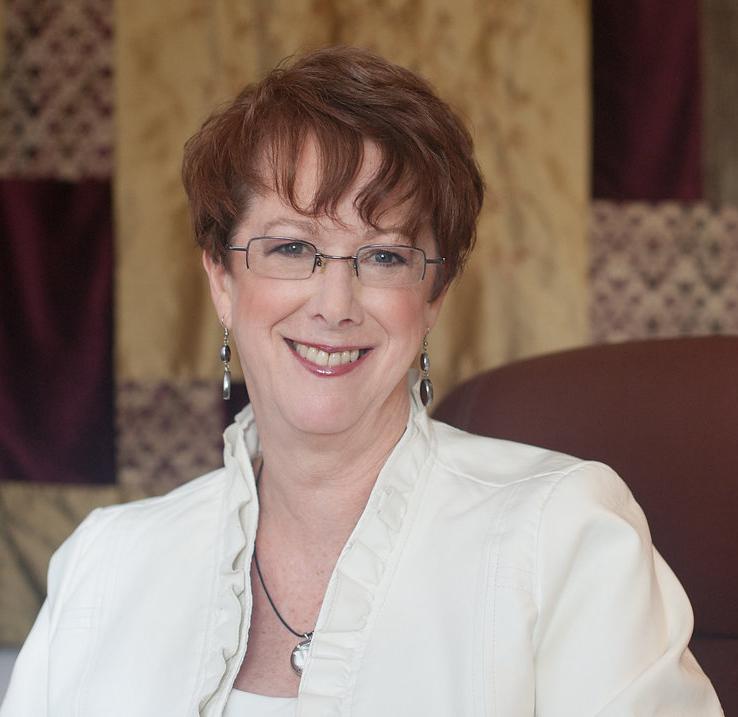 2018 Susan me headshot in chair web version